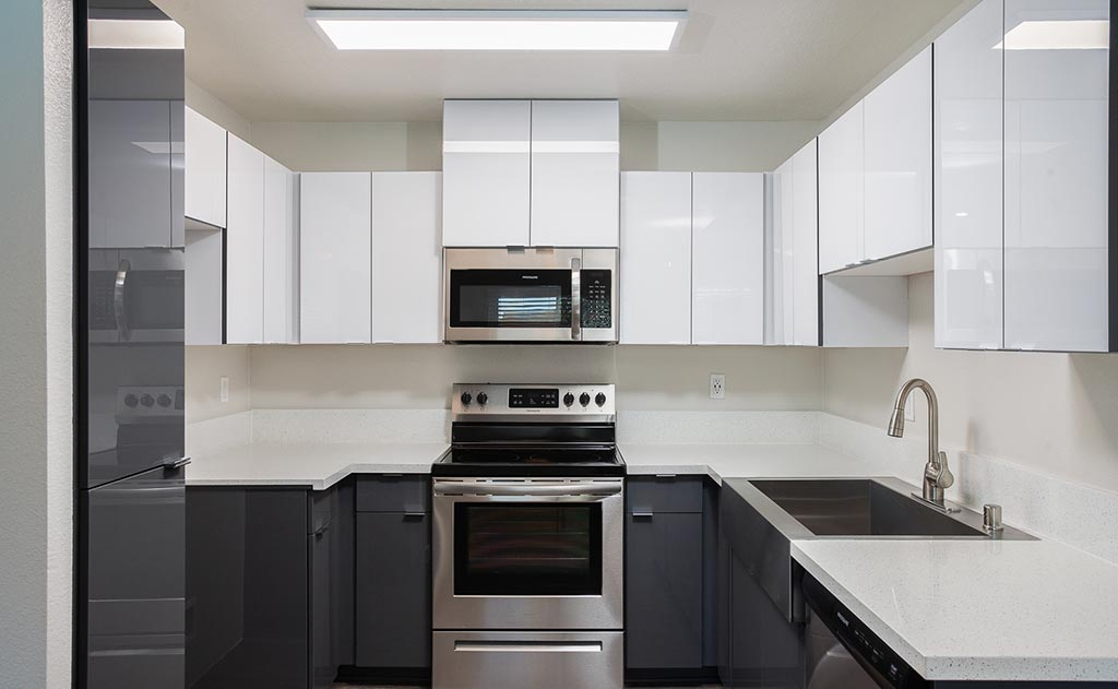 Kitchen with white and gray cabinets and countertops