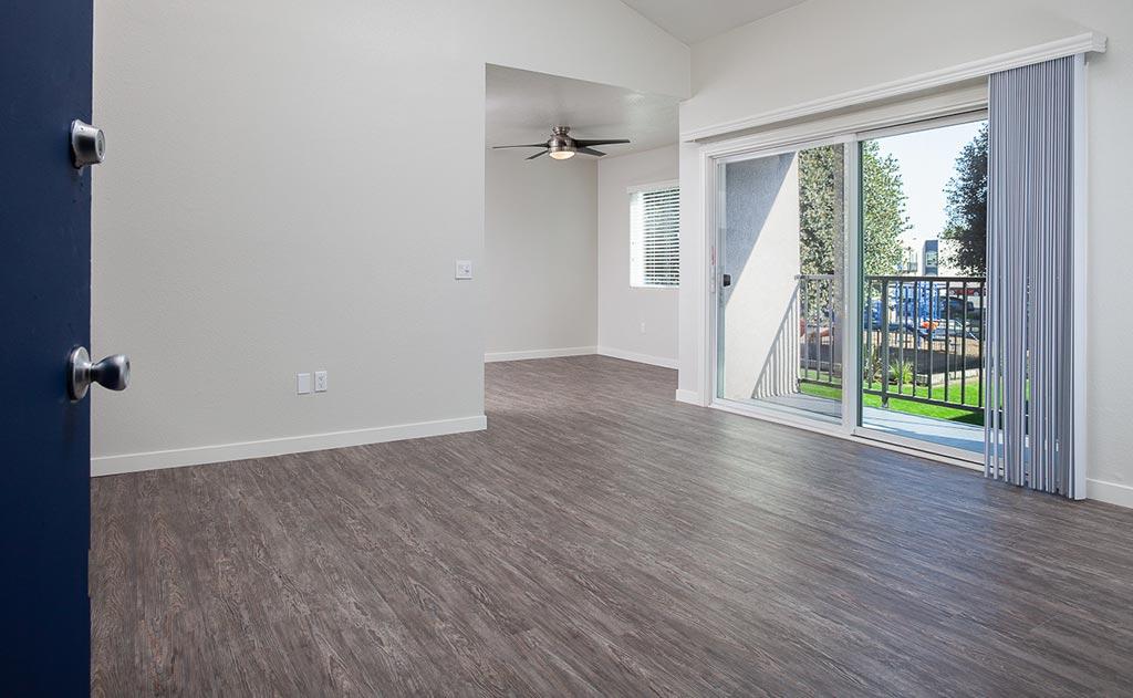 Empty living room with doors to patio