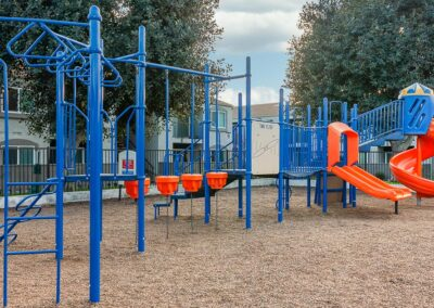 Playground area for kids with orange and blue playground equipment